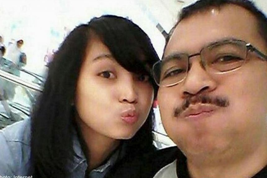 Angela Anggi Ranastianis, 22, the daughter of Captain Iriyanto, pilot of the crashed AirAsia Indonesia flight QZ8501, has made a televised plea to the public not to blame her father. -- PHOTO: INTERNET