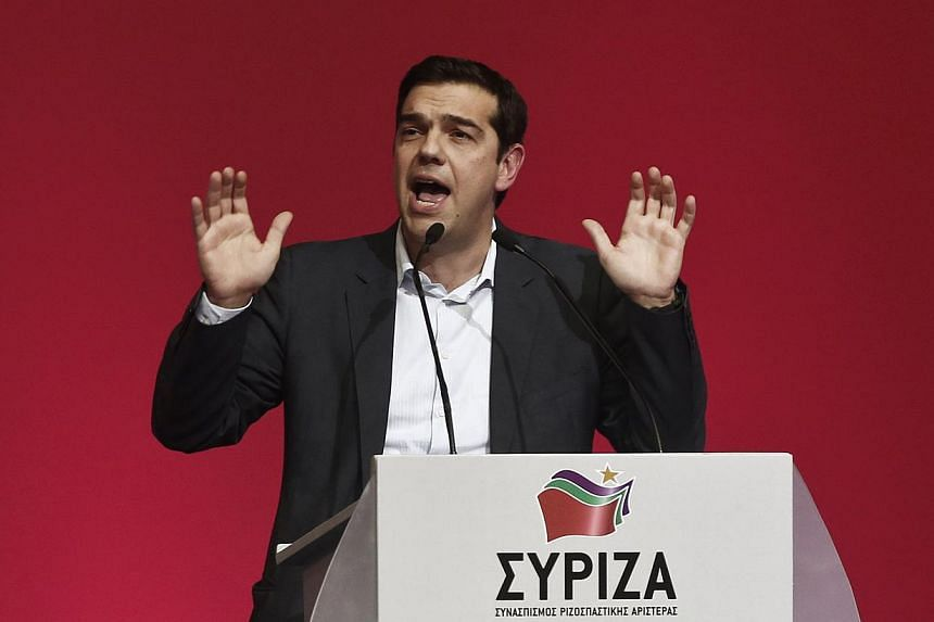 Alexis Tsipras, opposition leader and head of radical leftist Syriza party, delivers a speech during a party congress in Athens Jan 3, 2015.According to a report, the German government considers a Greece exit almost unavoidable if the Syriza pa