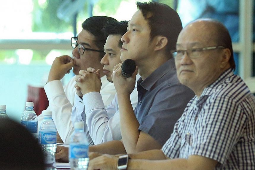 Member of Parliament for Sengkang West Dr Lam Pin Min (second from right) and chief executive of Life Corp Simon Hoo (second from left) seen during the dialogue session.-- ST PHOTO:NEO XIAOBIN