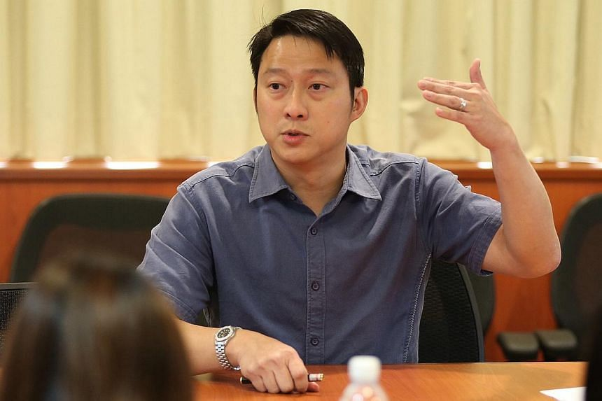 Member of Parliament for Sengkang West Dr Lam Pin Min addresses members of the media after the dialogue session.-- ST PHOTO:NEO XIAOBIN