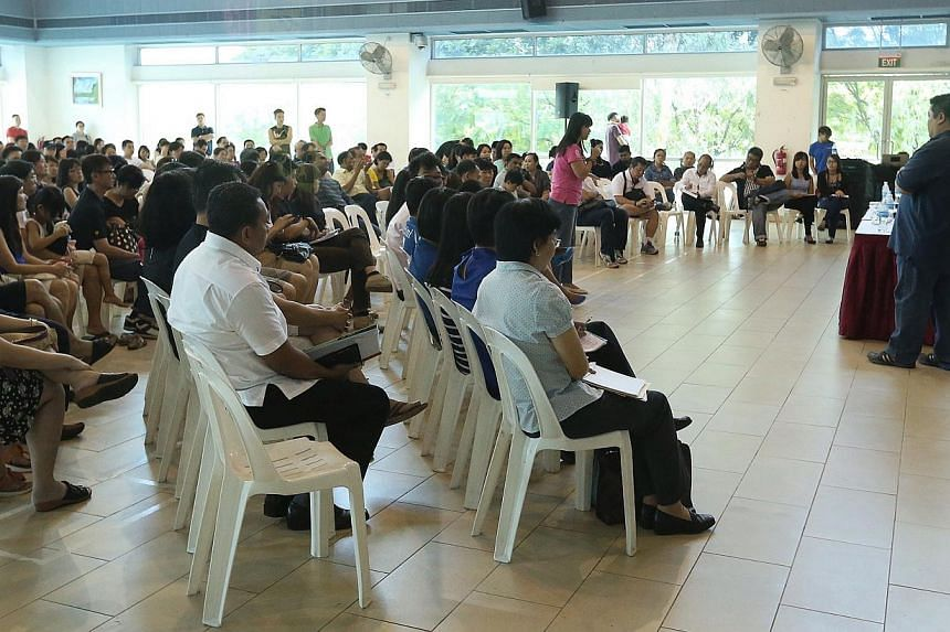 Members of the public seen during the dialogue session held at Anchorvale Community Club's multi-purpose hall on Jan 4, 2015.-- ST PHOTO:NEO XIAOBIN