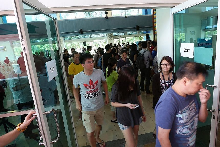 Residents leave the Anchorvale Community Club's multi-purpose hall after the dialogue session on Jan 4, 2015.-- ST PHOTO:NEO XIAOBIN