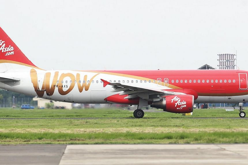 Shares of Malaysian-listed AirAsia Bhd tumbled back down on Monday after news of yet another incident over the weekend for Southeast Asia's biggest budget airline. -- PHOTO:ZAOBAO