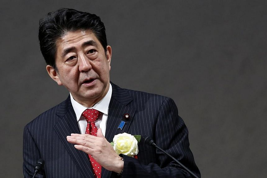 Japan's conservative Prime Minister Shinzo Abe said on Monday, Jan 5, 2015, that he would release a fresh statement on World War II this year, but would stand by previous apologies for wartime misdeeds. -- PHOTO: REUTERS