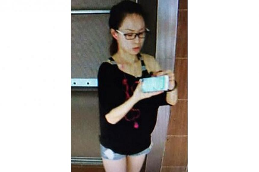 Police are looking for this woman, who is believed to be involved in a case of loanshark harassment near Sembawang Close on Jan 1. -- PHOTO: SINGAPORE POLICE FORCE