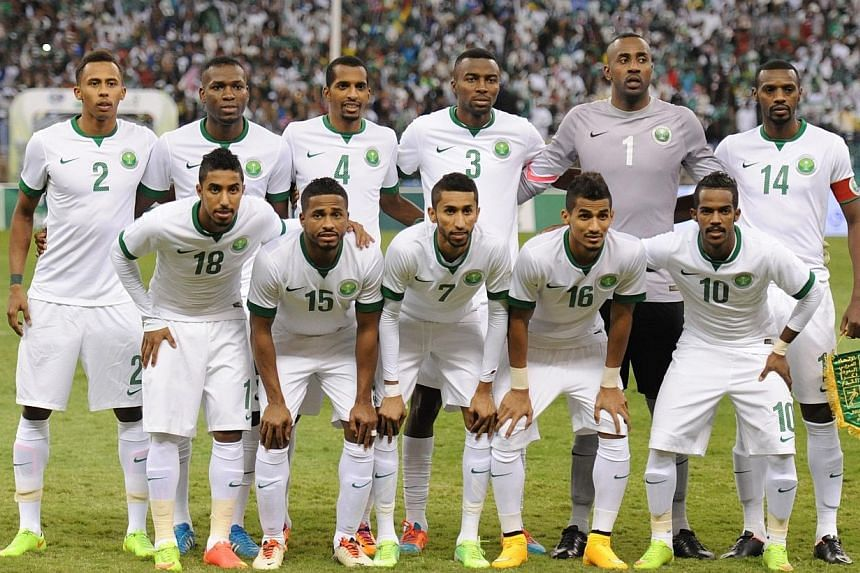 Saudi Arabia's starting eleven pose for a group picture ahead of the final of the 22nd Gulf Cup football match against Qatar at the King Fahad stadium in Riyadh, on Nov 26, 2014.Saudi Arabia's Asian Cup coach Cosmin Olaroiu has warned there was
