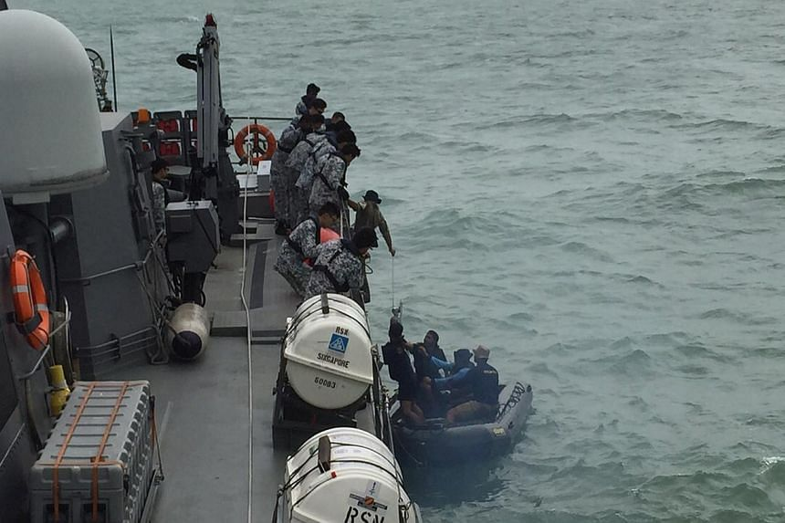 An Indonesian Navy seaboat (right) picks up items retrieved from the Republic of Singapore Navy vessel RSS Valour in this handout photo provided by Singapore's Ministry of Defence, released to Reuters on Jan 4, 2015. The warship has returned to Singa