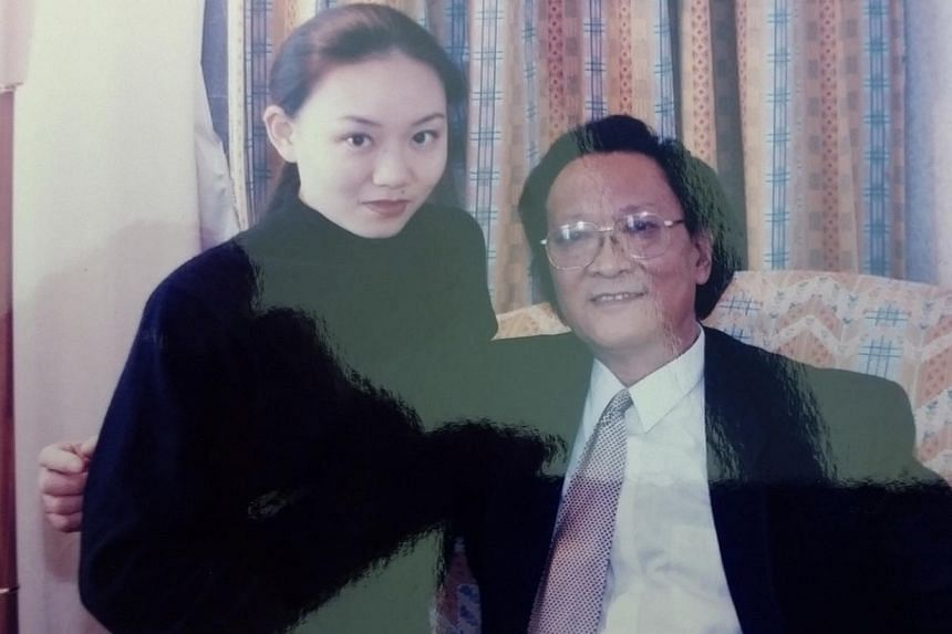 With her father, composer and violinist Qian Zhaoxi, in 2005.-- PHOTO: COURTESY OF QIAN ZHOU