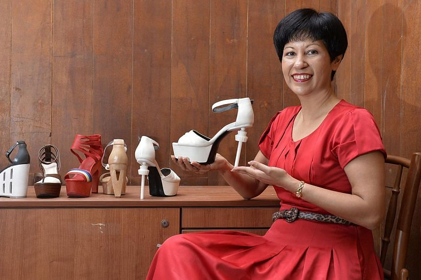 Ms Indranee wanted to create shoes with a Singaporean feel so she incorporated elements found in local landmarks and icons such as the Pinnacle@Duxton flats, Changi Control Tower and traditional wooden clogs.