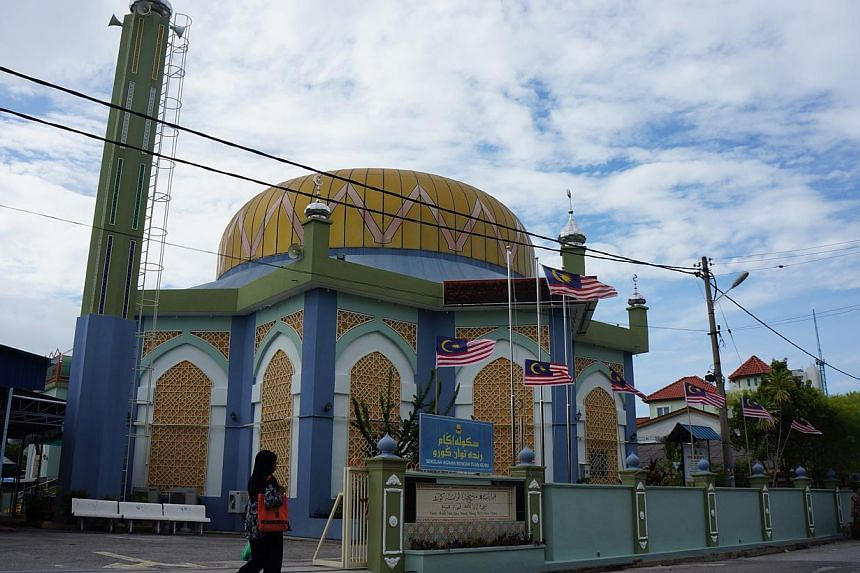Masjid Tuan Guru, the main mosque in Kampung Tanjung Tokong, one of the oldest Malay villages in Penang. The village occupies prime waterfront land just minutes from George Town's business district. A Chinese temple that sits within the old Malay vil