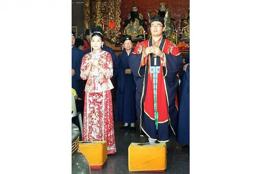Mr Chung Kwang Tong, the secretary-general of the Taoist Federation Youth Group, holding a Taoist wedding ceremony with hiswife Jacqueline, a Catholic at the San Qing Gong Temple. The couple held a uniquely Singaporean wedding, holding their we