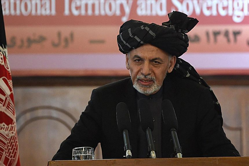 "Afghan President Ashraf Ghani said in an interview broadcast on Sunday that the United States might want to ""re-examine"" the timetable for removing the remaining U.S-led coalition troops in the country by the end of 2016. -- PHOTO: AFP"