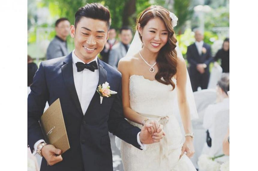 Singers Tay Kewei and Alfred Sim at their wedding.-- PHOTO:YU HSIN FROM TINYDOT PHOTOGRAPHY/ S2S PTE LTD