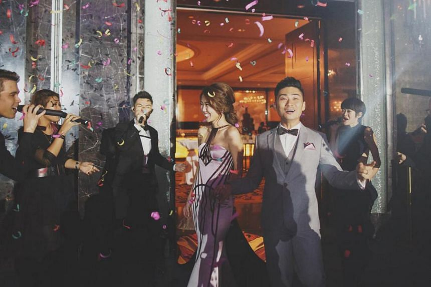 Singers Tay Kewei and Alfred Sim at their wedding. -- PHOTO:YU HSIN FROM TINYDOT PHOTOGRAPHY/ S2S PTE LTD