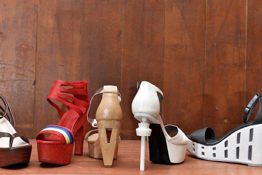 Shoes inspired by (from left) kueh lapis, cha kiak, Benjamin Sheares bridge, Changi Control Tower and Pinnacle at Duxton. -- ST PHOTO: DESMOND FOO