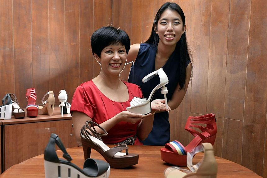 Ms Indranee Rajah and Shelin Chee, who helped designed the shoes together. -- ST PHOTO: DESMOND FOO
