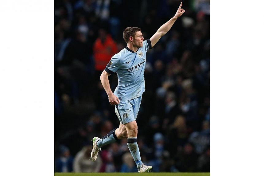 James Milner celebrating his goal against Sheffield Wednesday. -- PHOTO: REUTERS