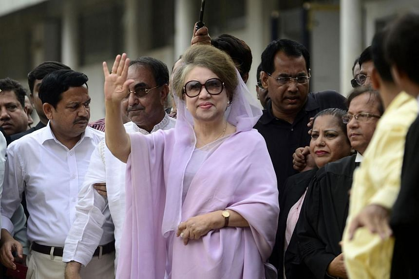 Trucks laden with sand and bricks were wedged outside the gates of Bangladeshi opposition leader Khaleda Zia's upmarket Gulshan office in Dhaka and at the mouth of the road leading to the building where she has been confined since Saturday night. --