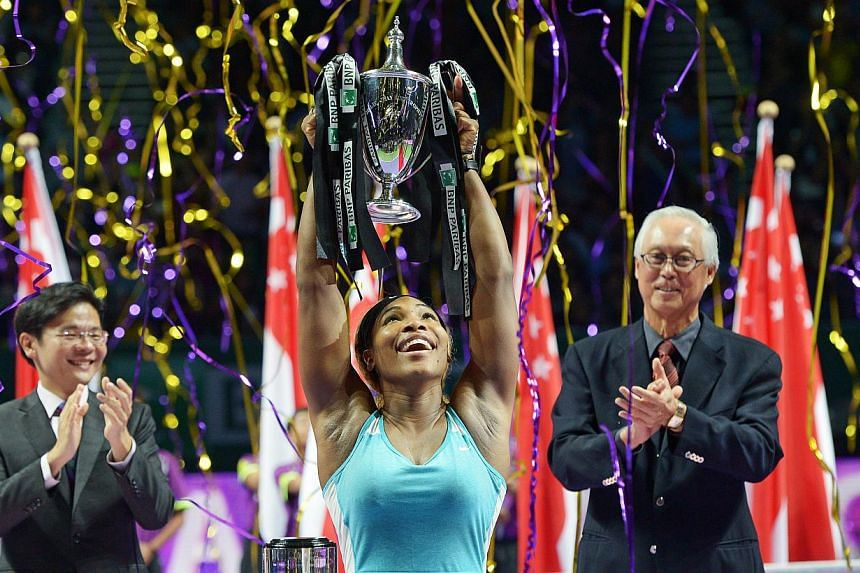A jubilant Serena Williams after trouncing Simona Halep 6-3, 6-0 to secure the Billie Jean King trophy at the BNP Paribas WTA Finals Singapore, cheered on by Culture, Community and Youth Minister Lawrence Wong (left) and Emeritus Senior Minister Goh