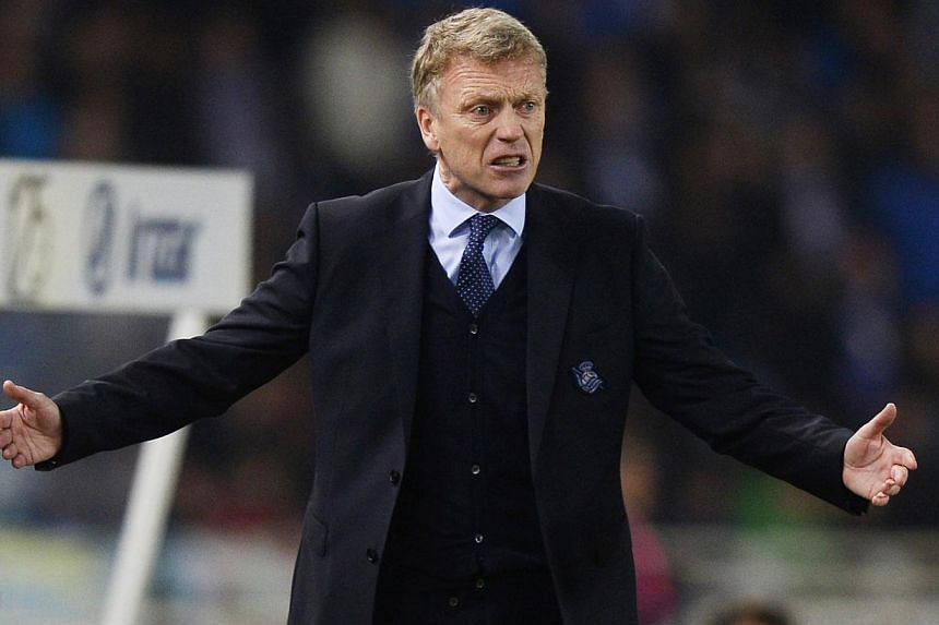 David Moyes on the sidelines of the clash with Barcelona. -- PHOTO: REUTERS