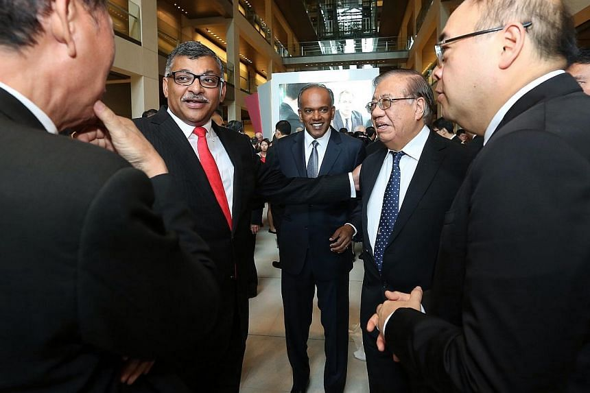 Chief Justice Sundaresh Menon (second from left) and Law Minister K. Shanmugam (centre) at theopening of the legal year.-- ST PHOTO: NEO XIAOBIN
