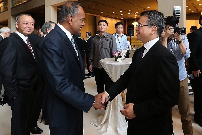 Law Minister K. Shanmugam (left) at theopening of the new legal year.-- ST PHOTO: NEO XIAOBIN