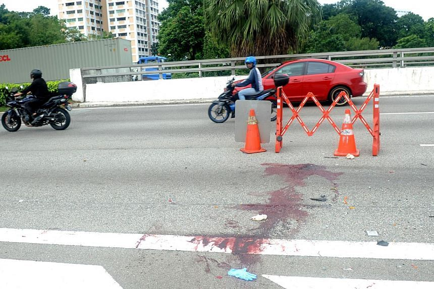 A trail of blood on the road where the accident occurred. -- ST PHOTO: TIFFANY GOH