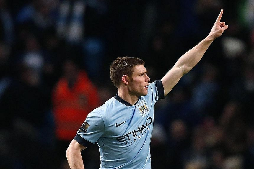 Manchester City's James Milner celebrates after scoring during their FA Cup third round soccer match against Sheffield Wednesday at the Etihad stadium in Manchester, England, on Sunday. -- PHOTO: REUTERS.