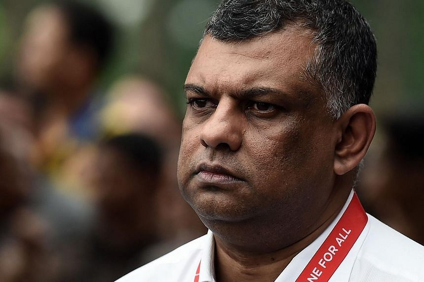 AirAsia Group chief executive officer Tony Fernandes waits prior to attending a press conference last week concerning missing Malaysian air carrier AirAsia flight QZ8501 at the crisis-centre set up at Juanda International Airport in Surabaya. -- PHOT