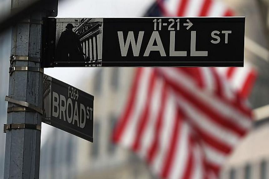US stocks tumbled in early trade on the New York Stock Exchange on Wall Street on Monday as renewed concerns about the eurozone sent the euro to a nine-year low. -- PHOTO: AFP