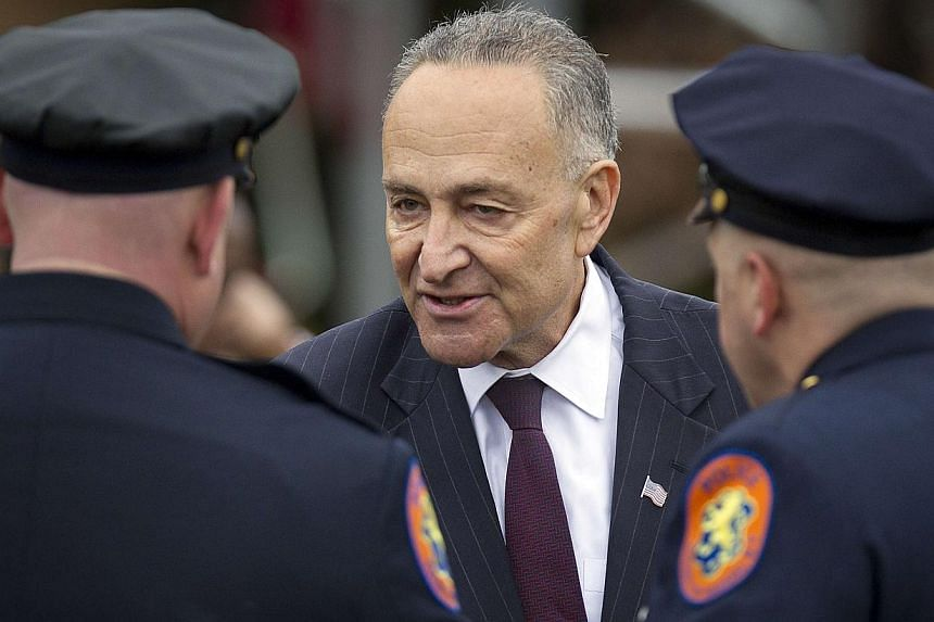 Senator Chuck Schumer (D-NY) arrives for the funeral of slain New York Police Department officer Liu Wenjian in the Brooklyn borough of New York on Jan 4, 2015. -- PHOTO: REUTERS