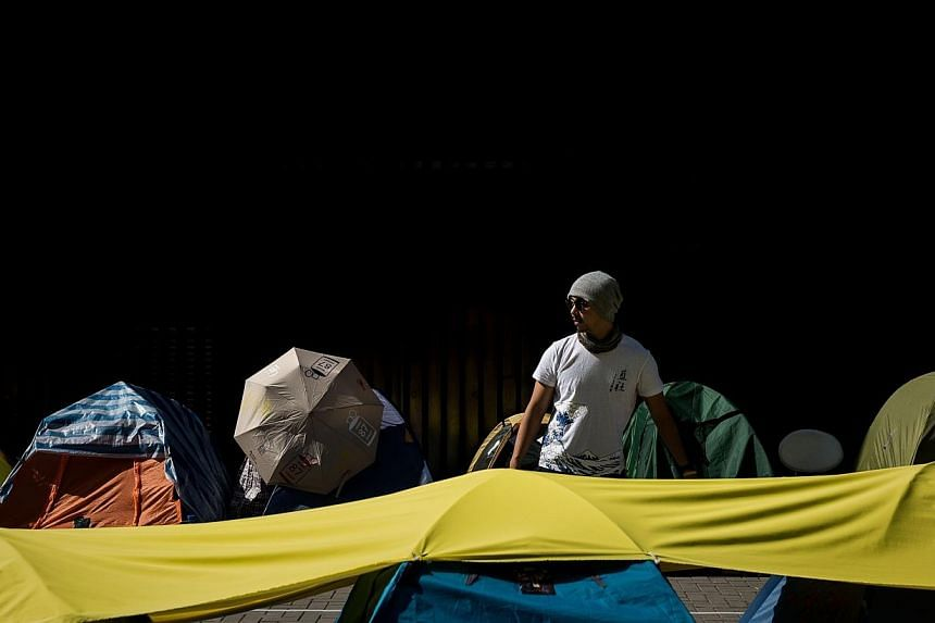 A supporter of the pro-democracy movement among the last few tents allowed to remain outside the government building in Hong Kong on Jan 6, 2015. Hong Kong's leader on Tuesday warned against fresh democracy protests ahead of the next step in the
