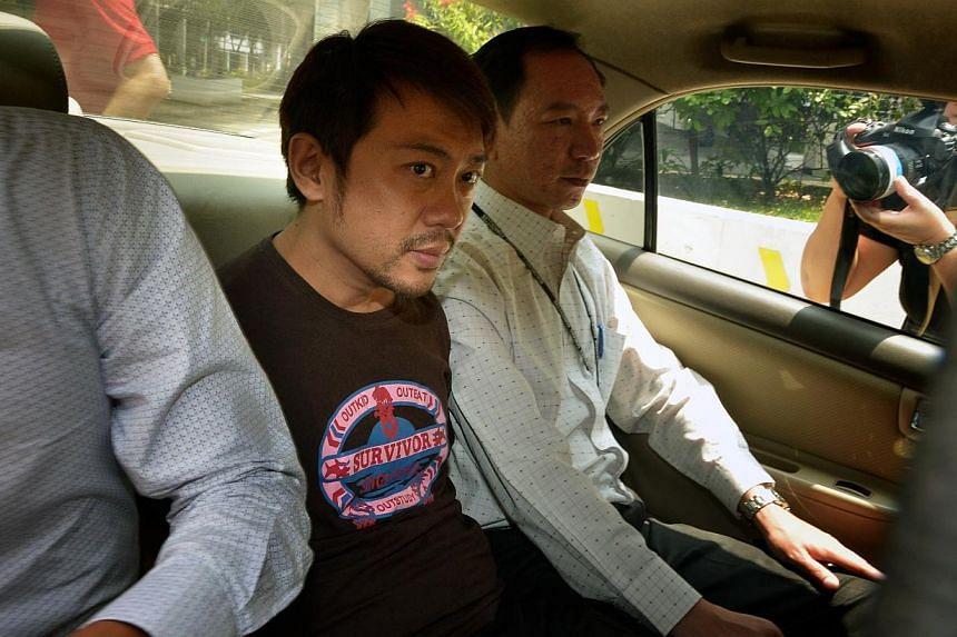 Mr Yang Yin in a police car on Nov 5, 2014.
