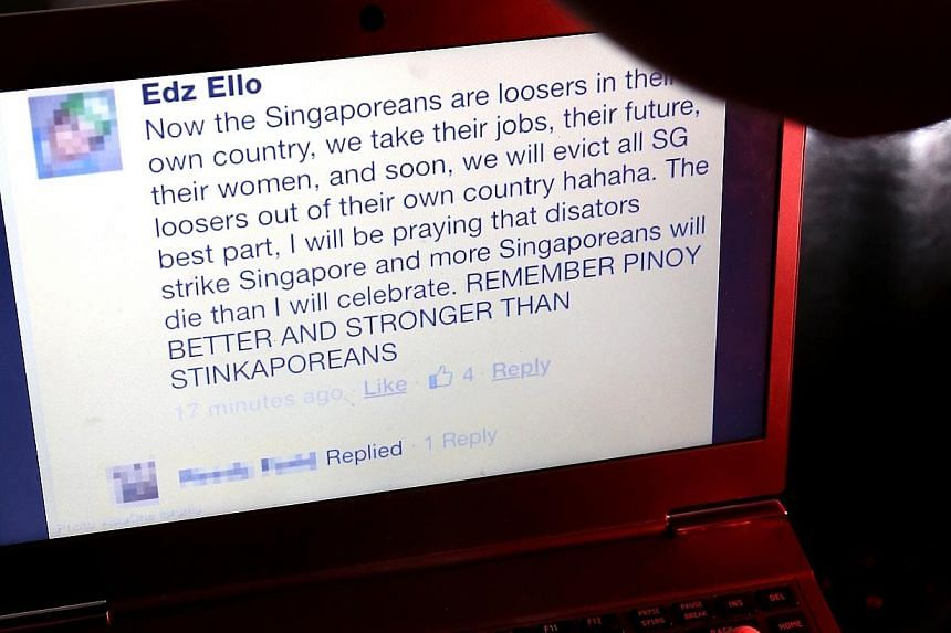 """A photo illustration of a man looking at a computer screen. The Philippine embassy in Singapore has told a Filipino nurse to be """"extra careful with his social media usage"""", days after disparaging remarks about Singaporeans appeared on his Facebook ac"""
