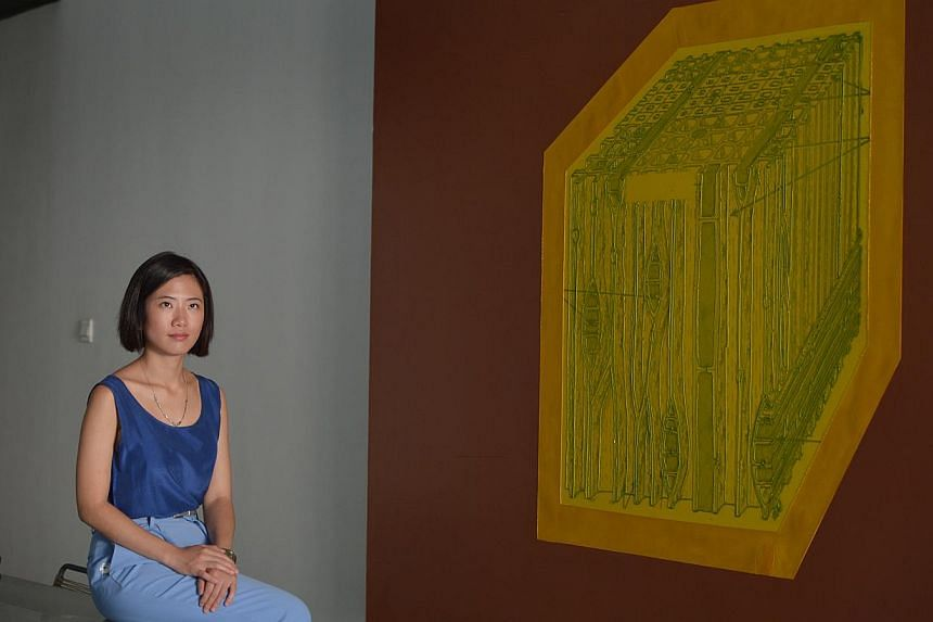 Long March Space gallery director Theresa Liang, with a work by artist Wang Jianwei.-- ST PHOTOS: CAROLINE CHIA