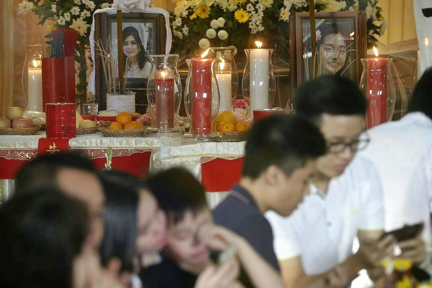 The wake of 44-year-old The Meiji Thejakusuma (left) and her 10-year-old daughter Jie Stevie, who were on AirAsia flight QZ8501 with five other family members, at Adi Jasa funeral home in Surabaya on Jan 4, 2015. -- PHOTO: ST FILE