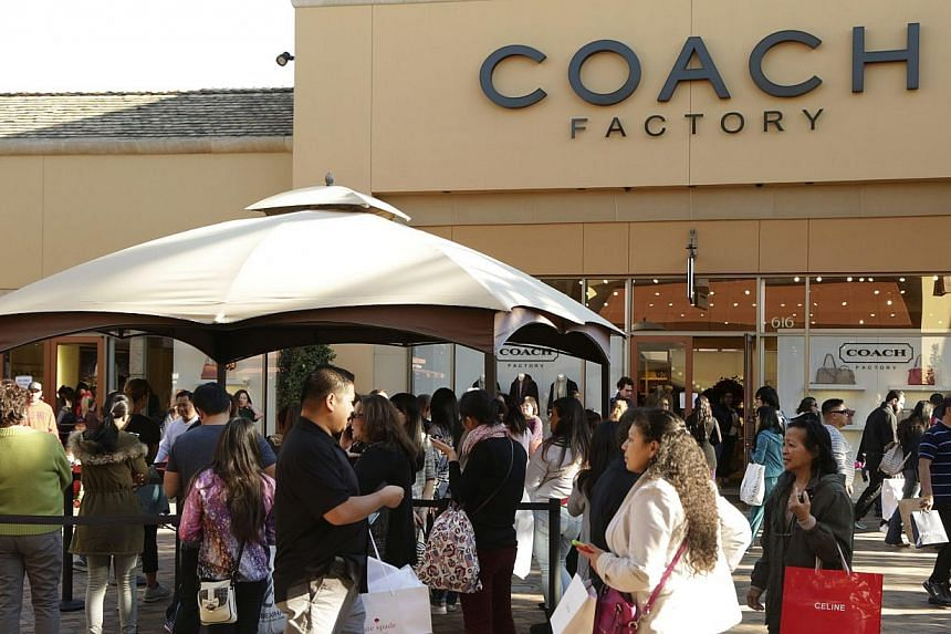People waiting in line to enter a Coach factory outlet store at Citadel Outlets in Los Angeles, California, on Dec 26, 2014. The accessories retailer is nearing a deal to buy privately held women's luxury shoe company Stuart Weitzma
