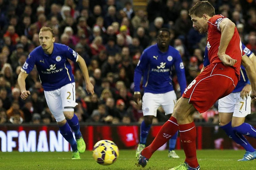 Liverpool's Steven Gerrard shoots to score a goal from a penalty during their English Premier League soccer match against Leicester City at Anfield in Liverpool, northern England Jan 1, 2015. -- PHOTO: REUTERS