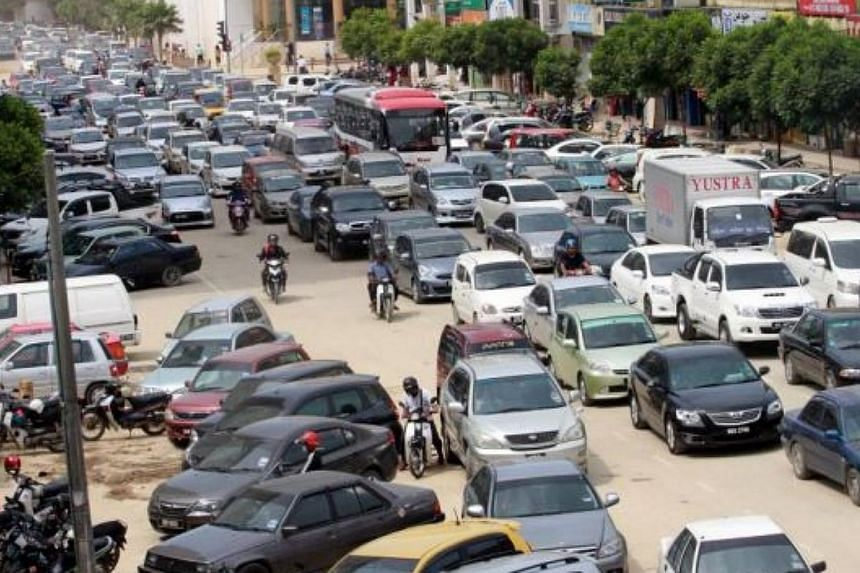 Jalan Padang Garong in Kota Baru is clogged with traffic, mostly from outside the state. -- PHOTO: THE STAR / ASIA NEWS NETWORK