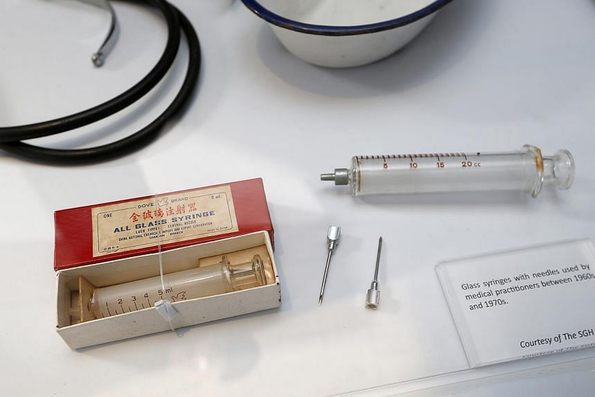 Glass syringes with needles used by medical practitioners between 1960s and 1970s. -- ST PHOTO: LAU FOOK KONG