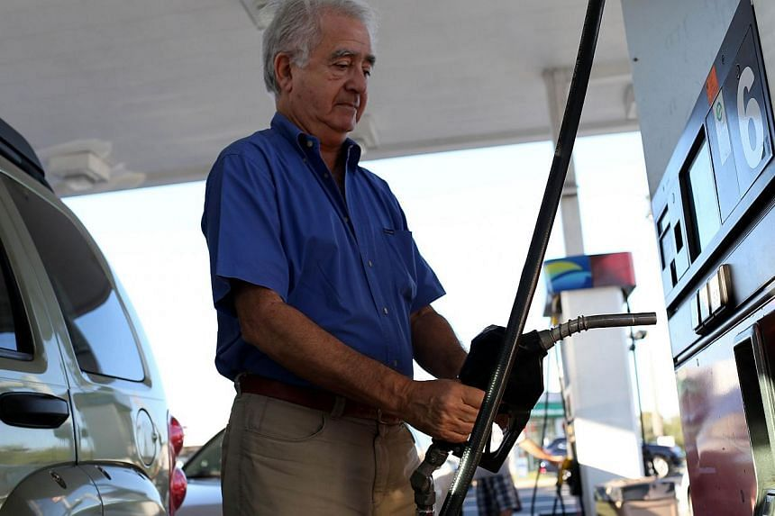 As oil prices plunge across the globe, petrol prices across the US drop even further much to the amazement of drivers finding veritable bargain prices at petrol stations like this one in Miami, Florida.-- PHOTO: AFP