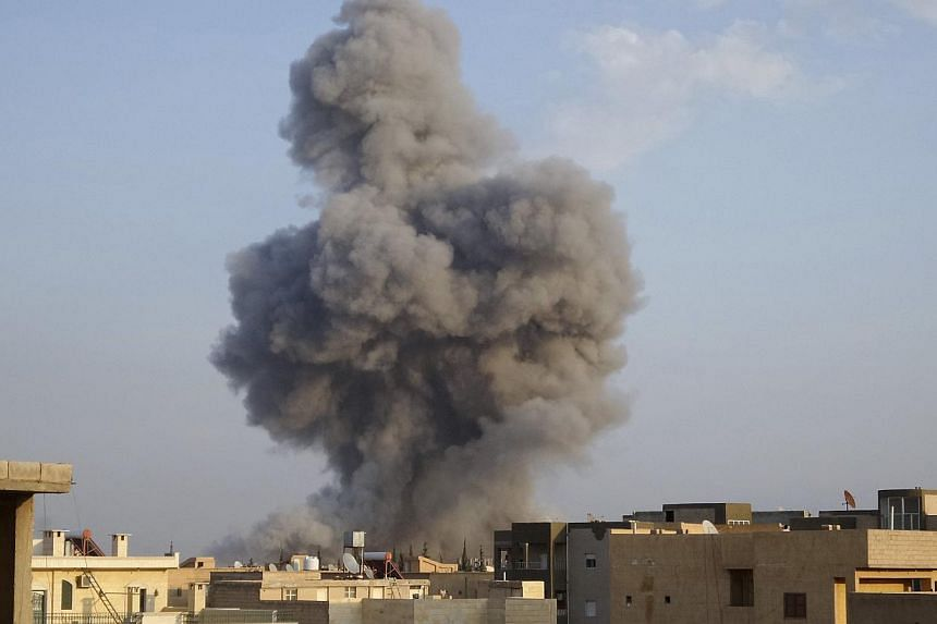 Smoke rising after a US-led air strike in Raqqa, eastern Syria, which is controlled by the Islamic State in Iraq and Syria (ISIS), on Oct 29, 2014. The US military is reviewing several incidents in which civilians may have been killed in coalition ai