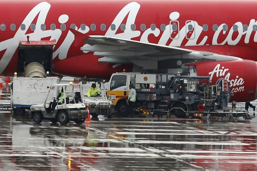 The Transportation Ministry suspended AirAsia's flight permit for the Surabaya-Singapore route on Jan 2. -- PHOTO: REUTERS