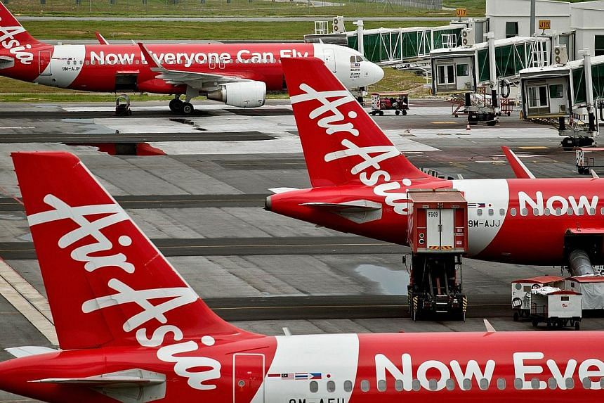 Three more weekly flights operated by Indonesia AirAsia to Singapore have been cancelled amid an official probe by the Indonesian authorities into the airline's flying permits. -- PHOTO: AFP