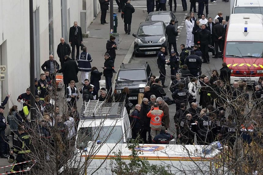 General view of police and rescue vehicles at the scene after a shooting at the Paris offices of Charlie Hebdo, a satirical newspaper, on Jan 7, 2015. -- PHOTO: REUTERS