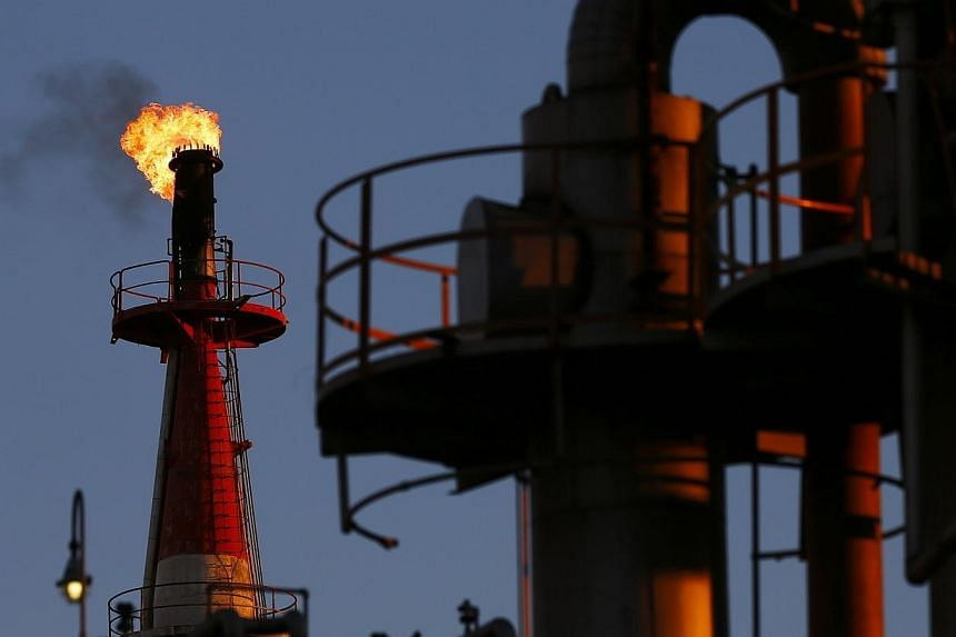 Oil prices will continue to drop as high production meets weak demand and a strong US dollar pressures crude, and markets will only pick up once major manufacturing economies particularly in Asia feel the benefit of cheaper energy. -- PHOTO: REUTERS