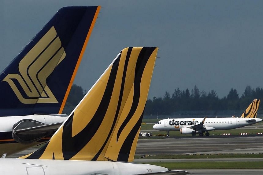 Shares of Singapore Airlines and Tiger Airways extended gains for a second straight session as oil prices, a major component of their operating costs, continued to sink. -- PHOTO: REUTERS