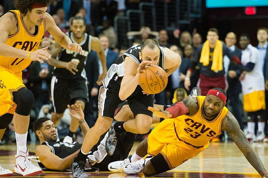 Manu Ginobili (#20) of the San Antonio Spurs steals the ball from LeBron James (#23) of the Cleveland Cavaliers during final seconds of the second half at Quicken Loans Arena on Nov 19, 2014 in Cleveland, Ohio. The Cavaliers are no longer favoured to