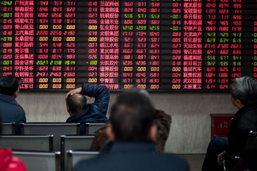 China's stock market watchdog has approved the initial public offerings of 20 firms, it said late on Monday. -- PHOTO: AFP