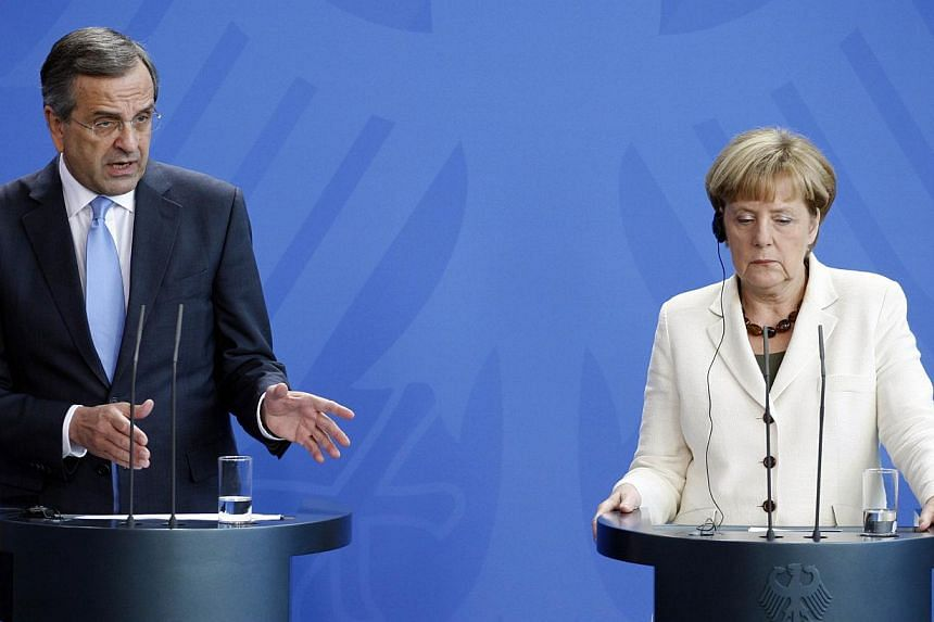 German Chancellor Angela Merkel (right) and Greek Prime Minister Antonis Samaras at a joint press conference at the chancellery in Berlin on Sept 23, 2014. -- PHOTO: AFP